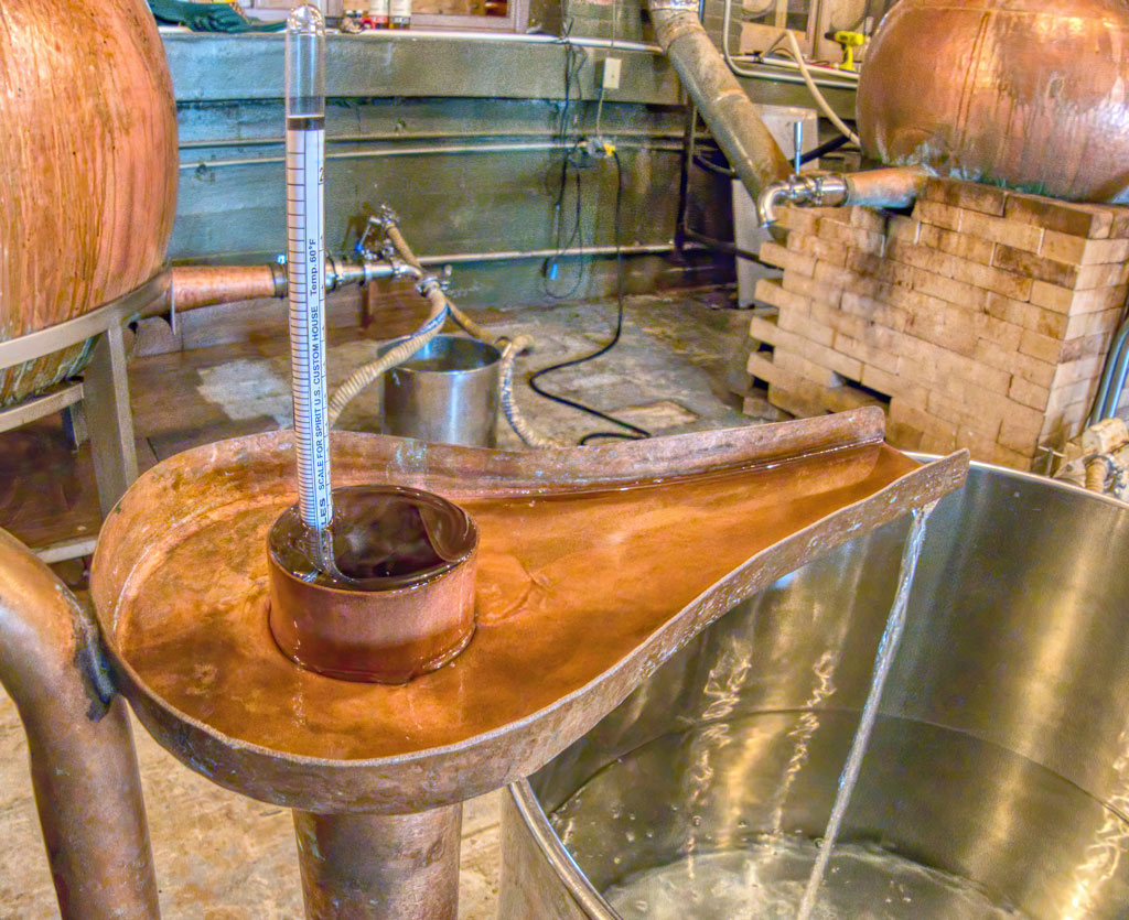 distillate from pot still a Maggie's Farm Rum Distillery